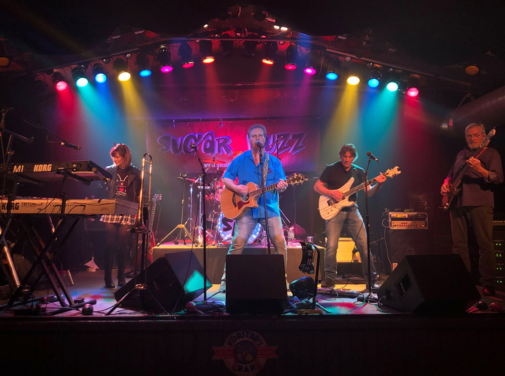 Rocking out on stage | Sugar Buzz Band